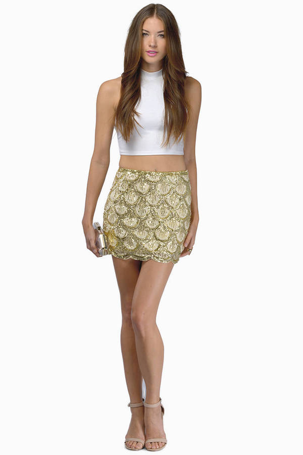 Get that antique look with gold sequin skirts