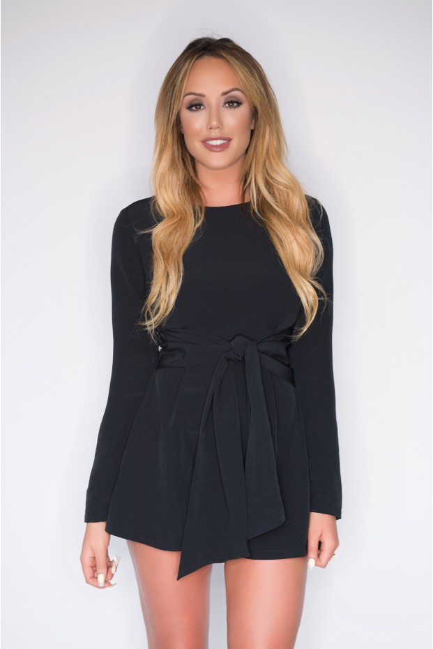 Wearing the black playsuit for that executive look