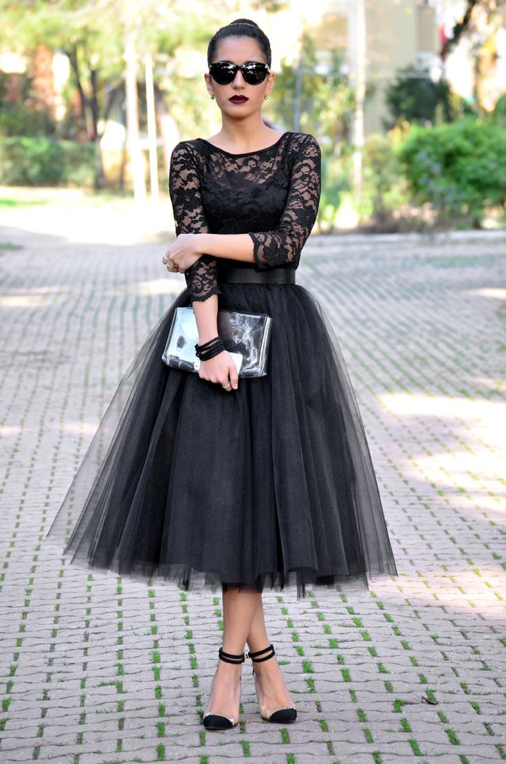 the project is wearing a custom made black tulle skirt, black lace top from KXHOUFI