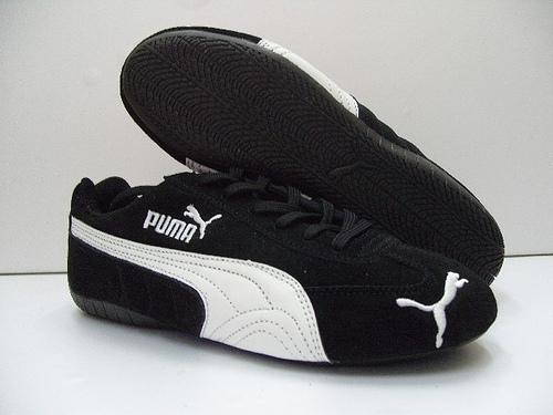 the puma speed cat in itu0027s most common color scheme, blacku0026white UEOSJFU