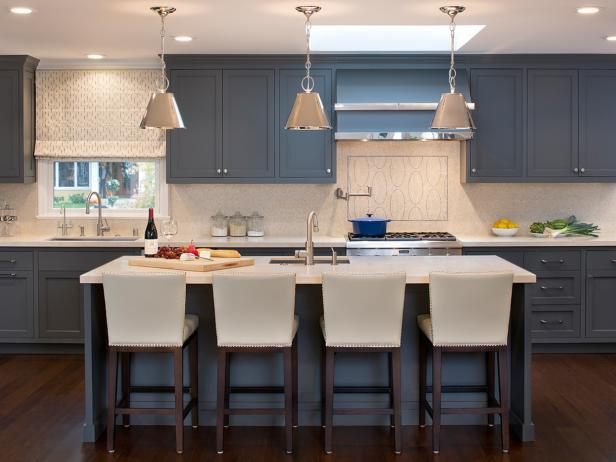 bar stool for kitchen island transitional kitchen with blue cabinets and white barstools IYUZLPD