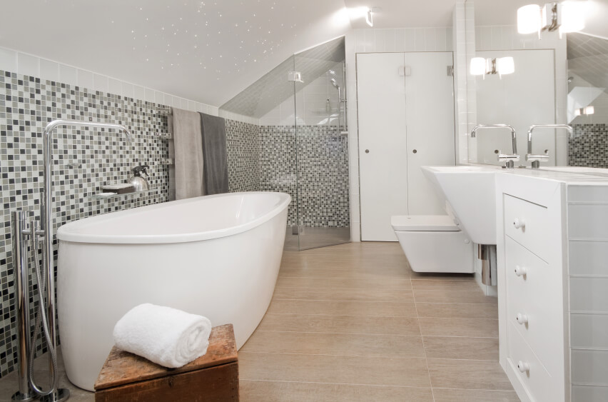 bathrooms pitched roof a spacious attic bathroom in gray and white with a large swath of glass TFJWKQQ