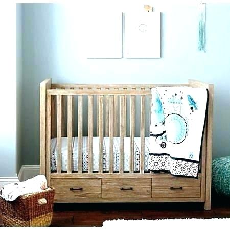 cribs with storage underneath under crib storage fargo types of cribs YYIMGIV