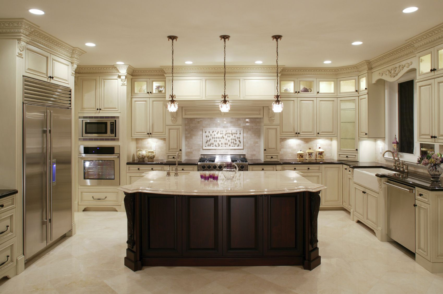 u shaped kitchen layout with island this u-shaped kitchen centers around a large dark wood island with classic AUWKKEH
