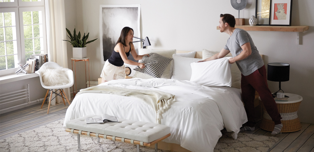 Best mattress for couples - couple making bed