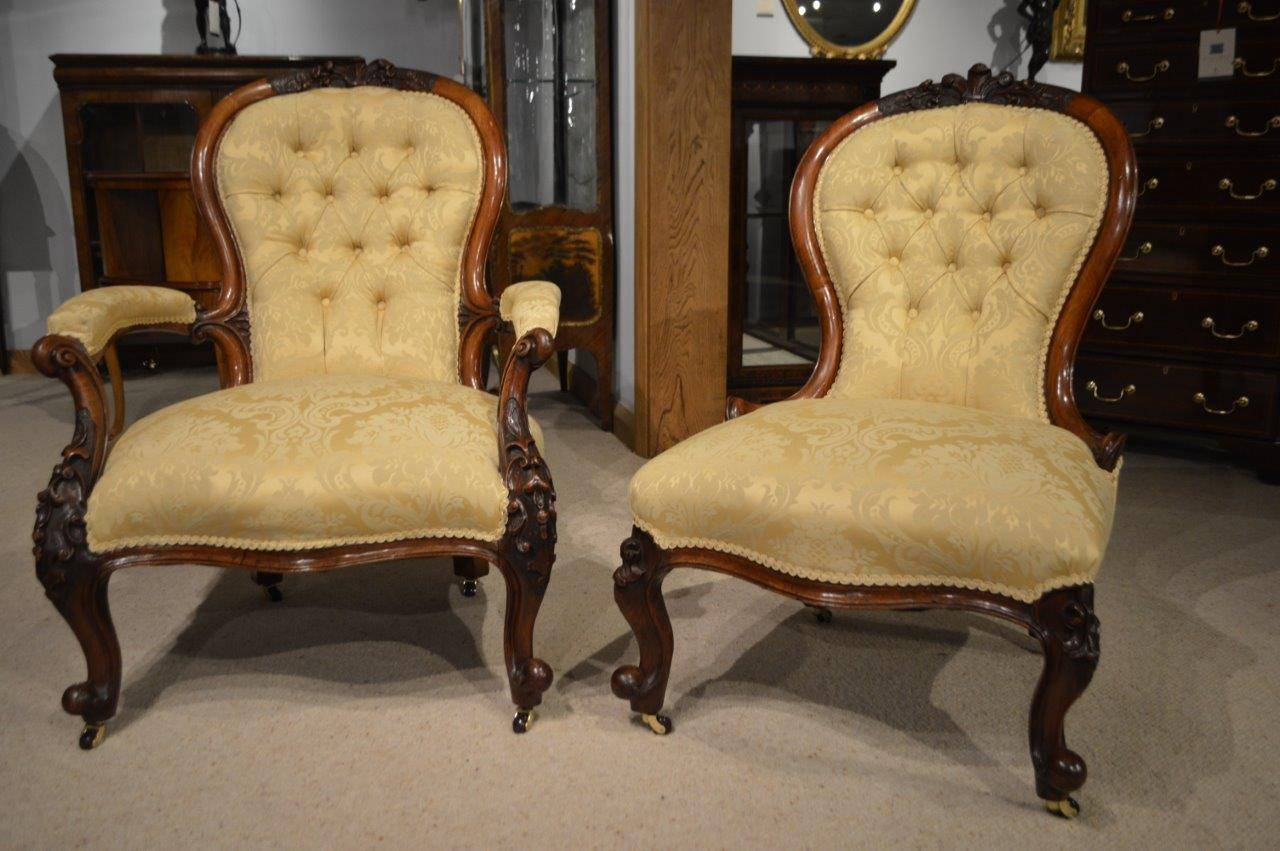 A lovely pair of walnut Victorian Period antique chairs. Each having a  shaped deep buttoned