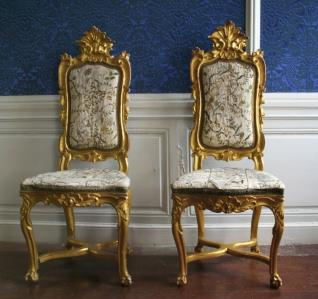 two antique gold chairs