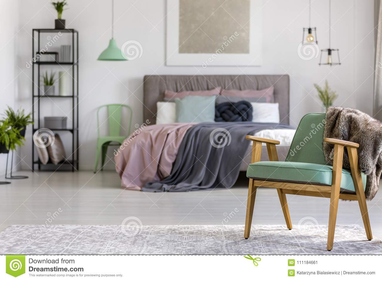 Green wooden armchair in bedroom