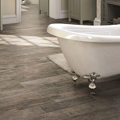 Introduce a natural element to your bath with resilient, water-resistant  wood or stone look porcelain tile. Tiled floors