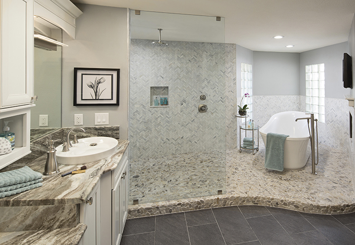 Remodeled master bathroom with rain showerhead and standalone tub