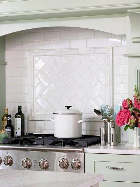 Subway tile backsplash with herringbone pattern behind stove top