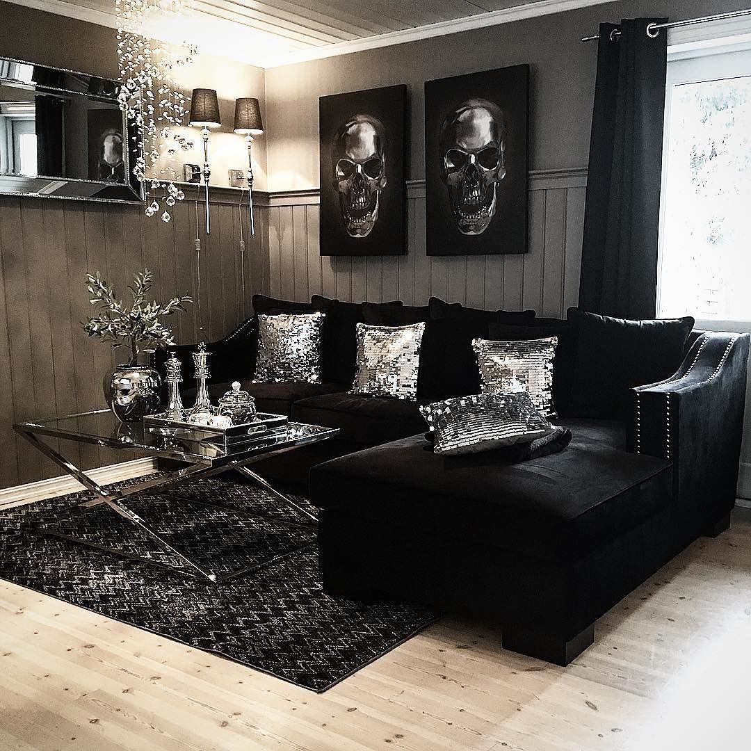 This living room is bad ass. Silver sequin pillows, shiny metallic accents,  dope skull wall art