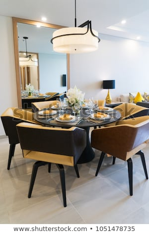 Dining table setting for dinner party at home. Cozy comfortable dining area  with stylish arrangement
