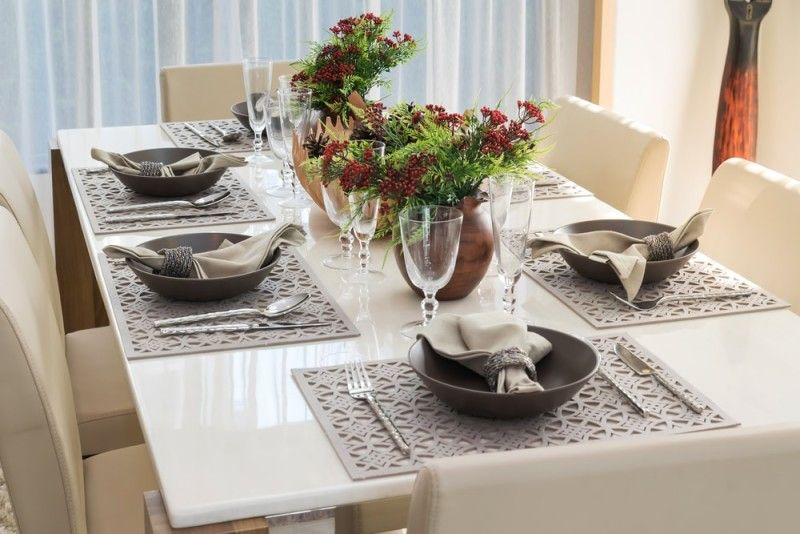 Six piece dining table setting with cream colored comfortable chairs and  matching napkins and tablemats