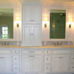 White Bathroom Cabinetry with two sinks create a double vanity for a  home in Berwyn,