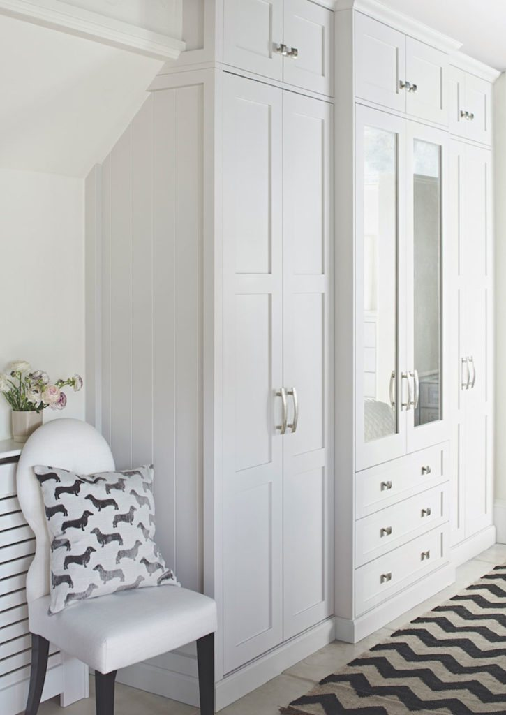 Seen here in white, this Shaker-style in-frame fitted wardrobe, priced from  £5,000 from John Lewis of Hungerford blends beautifully into the bedroom.