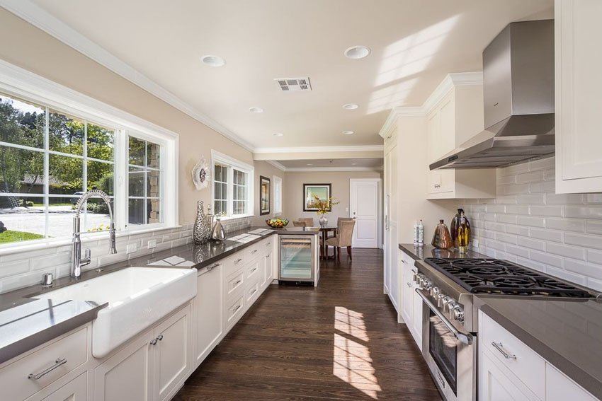Traditional galley kitchen with white cabinets backsplash