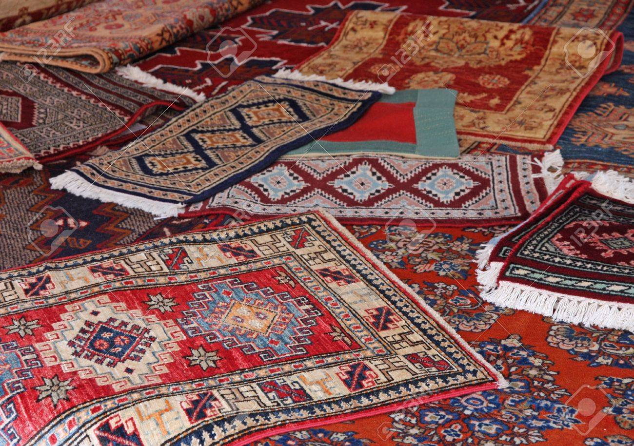 Stock Photo - textures and background of ancient handmade carpets and rugs