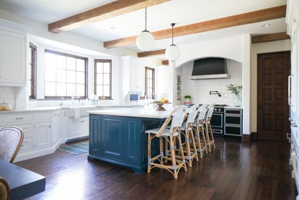 Spacious Transitional Kitchen With Blue Island, Globe Pendant Lights  Between Exposed Beams and