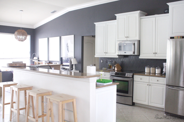 I finally finished painting my entire kitchen — walls, cabinets, and  backsplash. It looks like a different kitchen! It was very economical  (about $200),