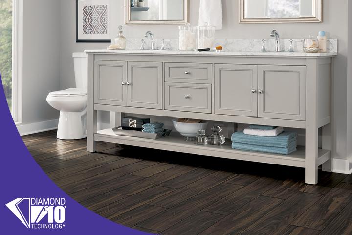 Wood-look luxury vinyl tile in a bathroom - Goncalo Aves Espresso U4051