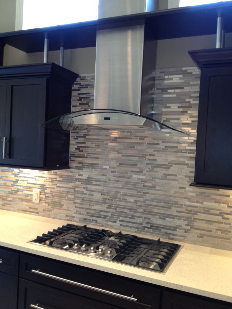 Glass and Stainless Steel Linear Backsplash---what great backsplash tile!  So modern! #RCI