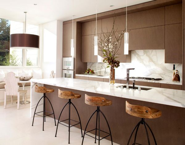 View in gallery Exquisite modern kitchen in white and brown with sleek  pendant lights above the kitchen island