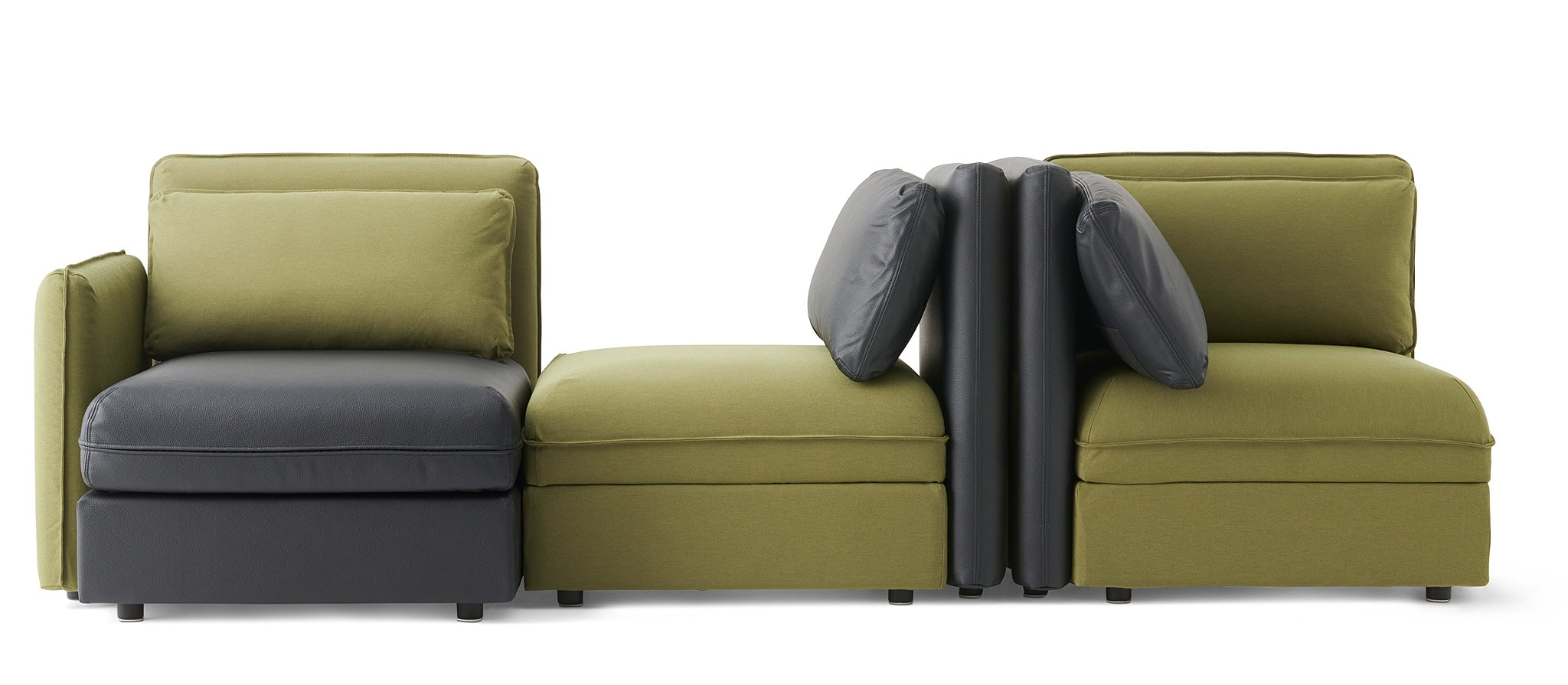 This combination of olive green and black VALLENTUNA modules can form a  dynamic sofa that sits