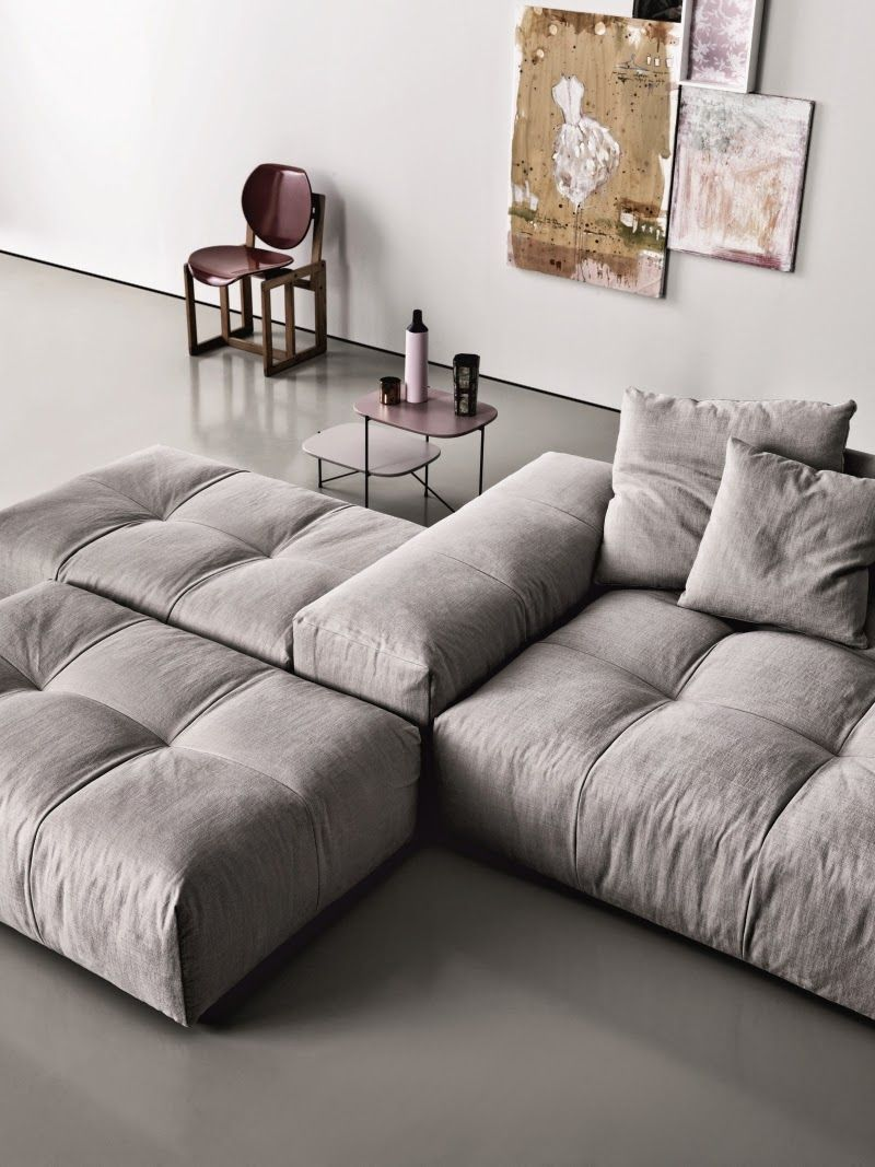 Modular sofa with back/arm big enough to sit on.