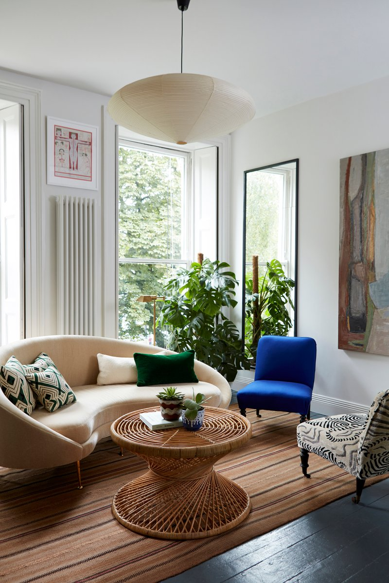 British interior designer Beata Heuman brought organic modernism to a flat  in Holland Park, London via the grouping of a cream-colored round sofa with  a