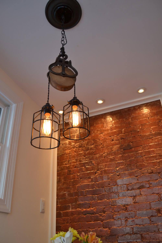 2. Barn Pulley Makes Perfect Hanging Lamp