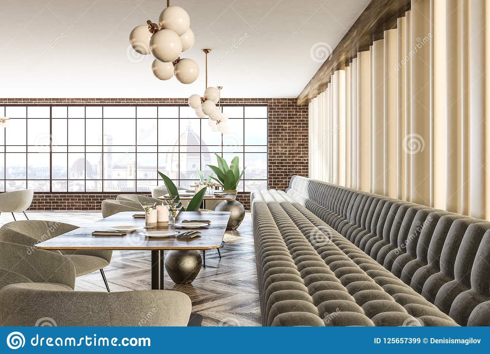 Brick wall gray sofas and armchairs cafeteria