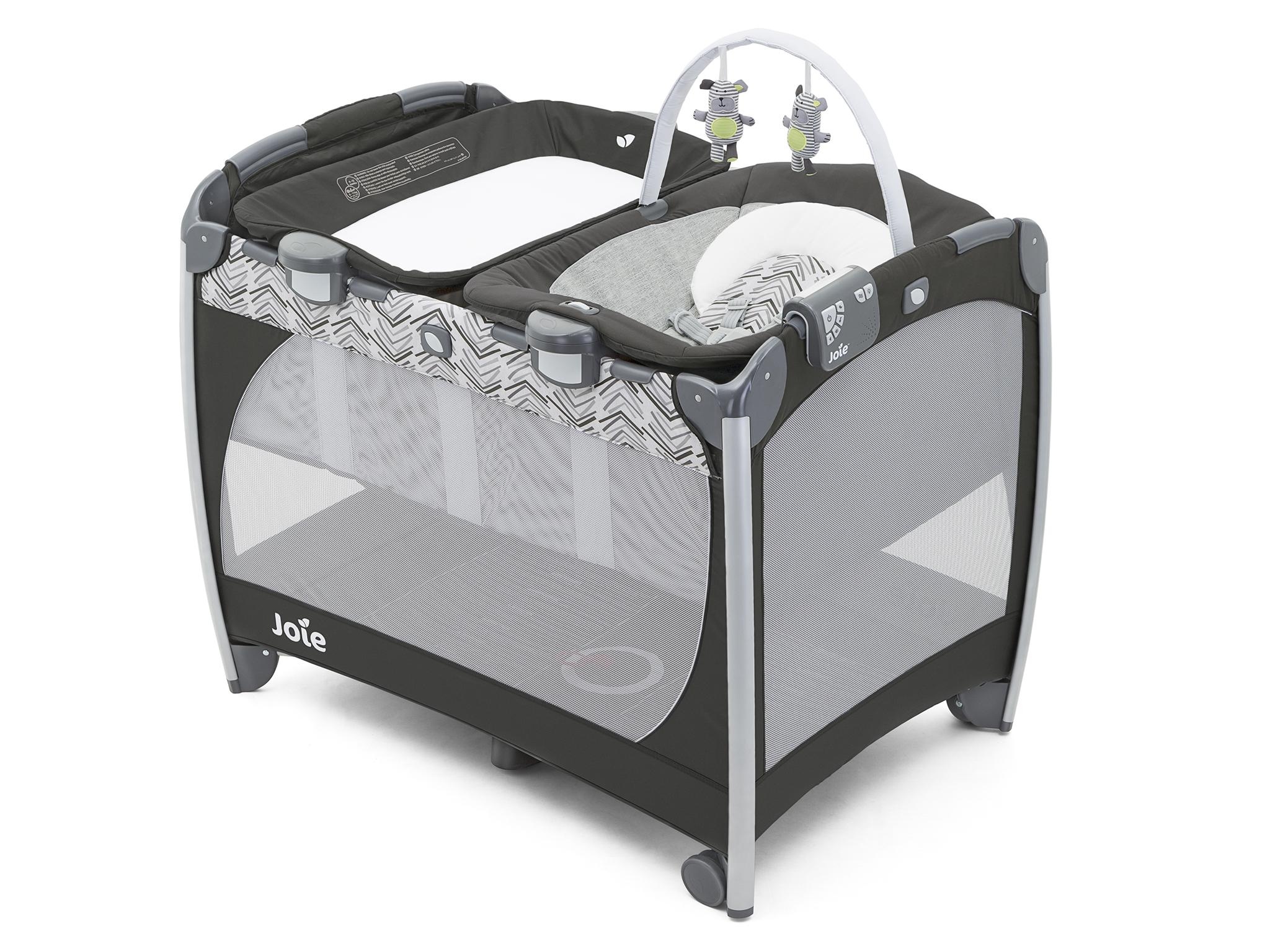 This is a lot more than just a travel cot: it includes a portable changing  unit that can be placed on top of the cot, a bouncy seat with a music (five