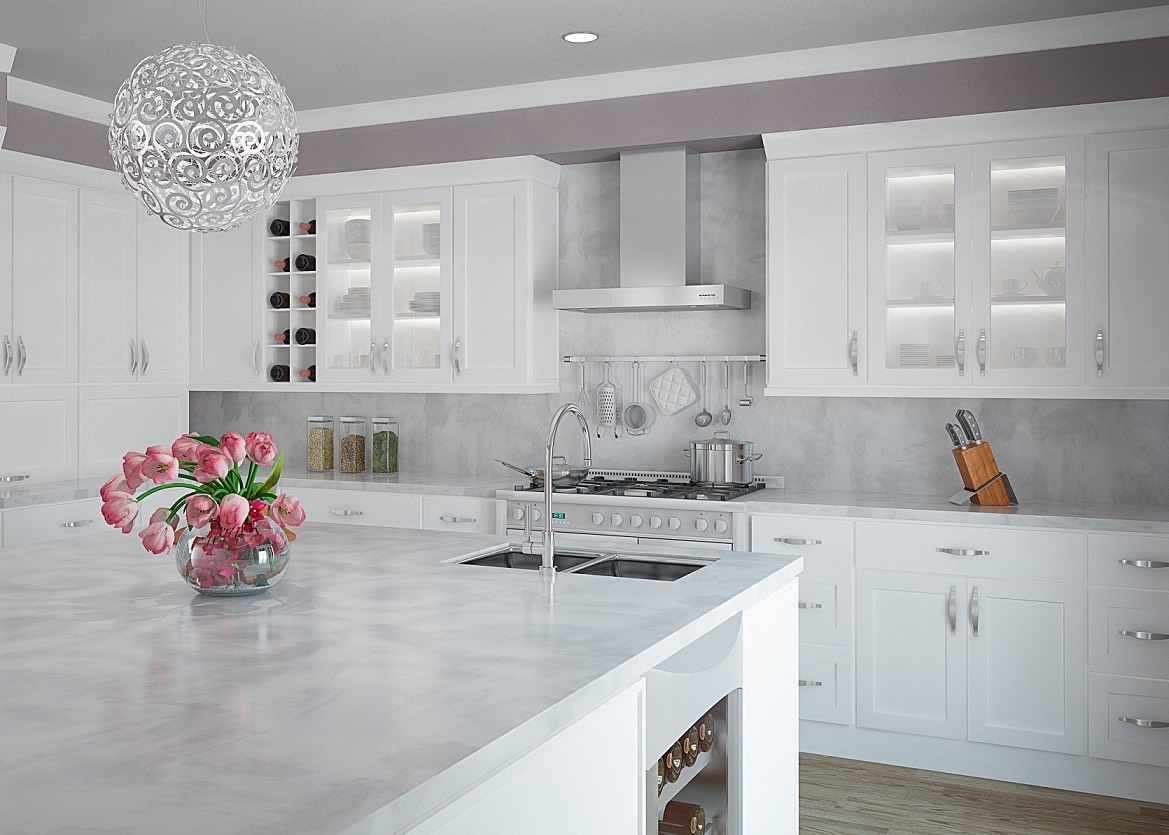 Modern kitchen with large, clean island and white kitchen cabinets.