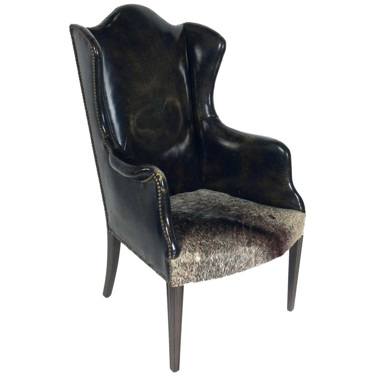 Antique Leather and Cowhide Wingback Armchair For Sale