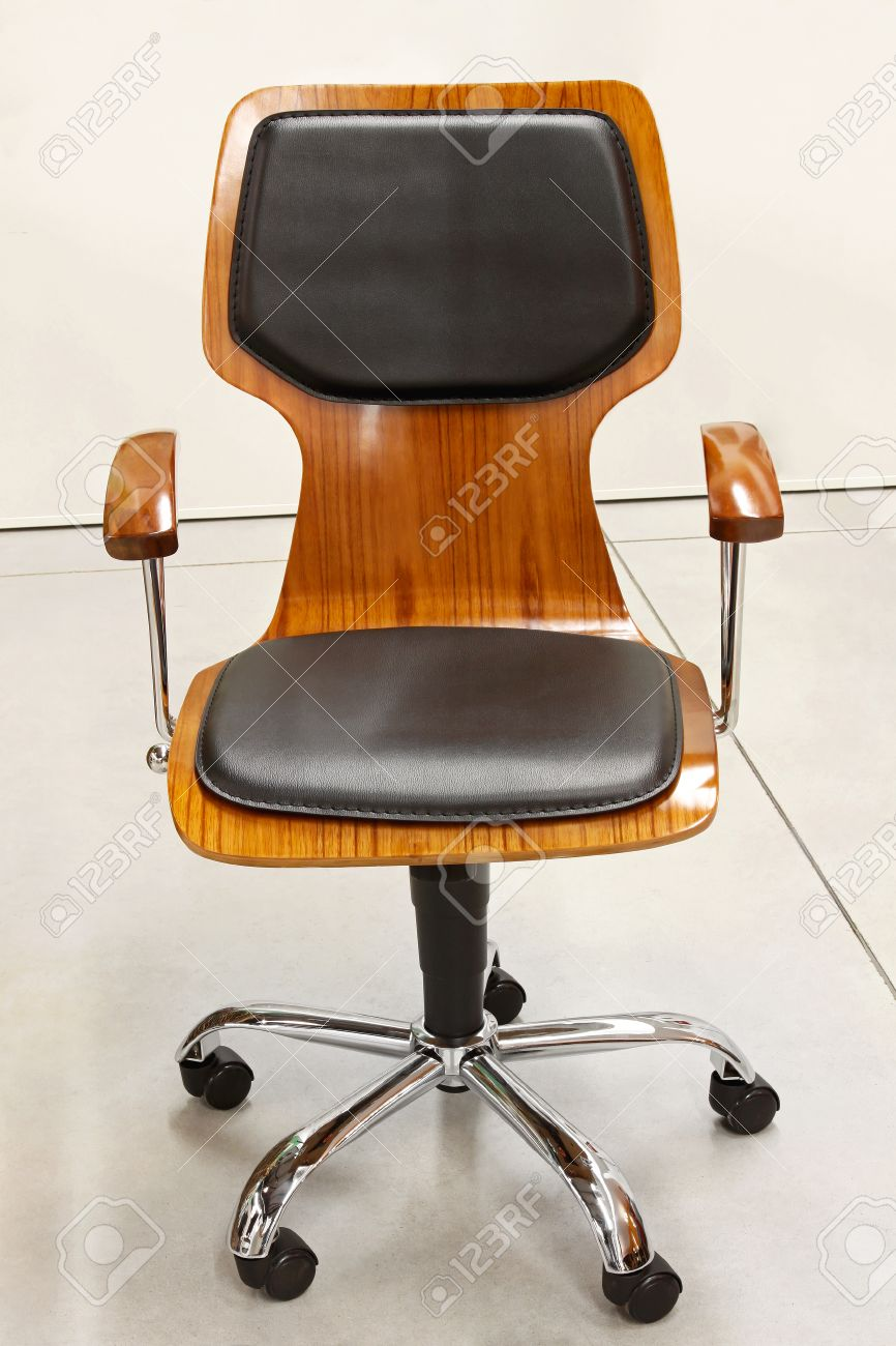 Modern wooden office chair with leather cushions Stock Photo - 23204498