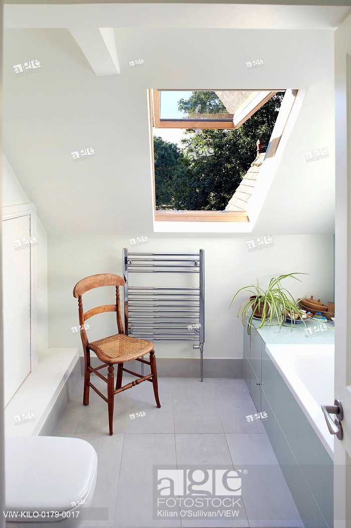bathrooms pitched roof stock photo: bathroom with pitched roof and velux window. wendell rd,  london, CVOYFMV