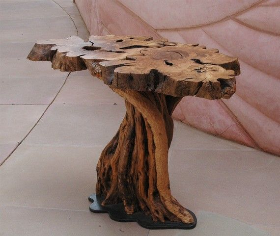 Furniture made of olive wood this table is made of branches pruned from an ancient olive tree. the wood IEQBNVW