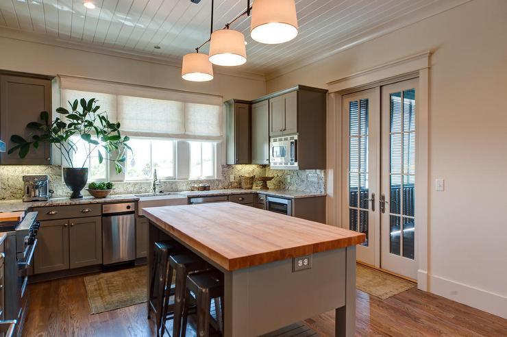 Kitchen with freestanding kitchen block butcher block island with tolix stools XSUDMJP