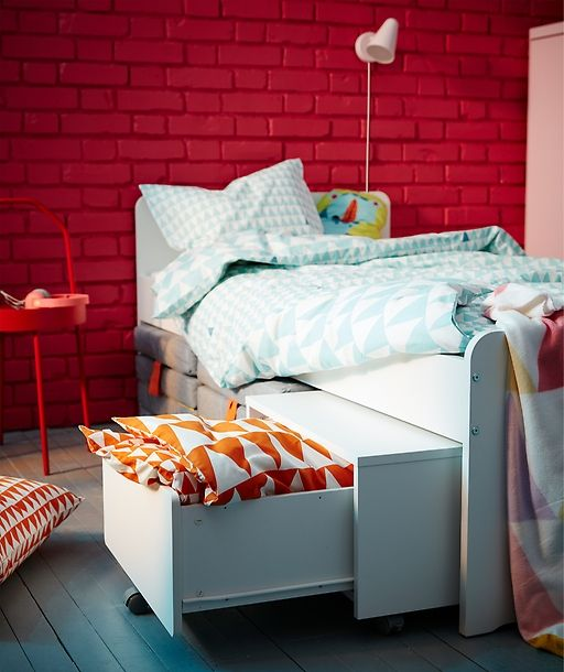 IKEA SLÄKT white bed and kid's storage unit are a small space