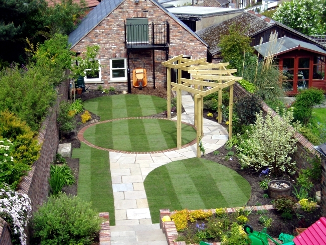 First, decide if you want to create a formal or informal atmosphere in the  garden. Informal designs follow the natural terrain and use long curves,
