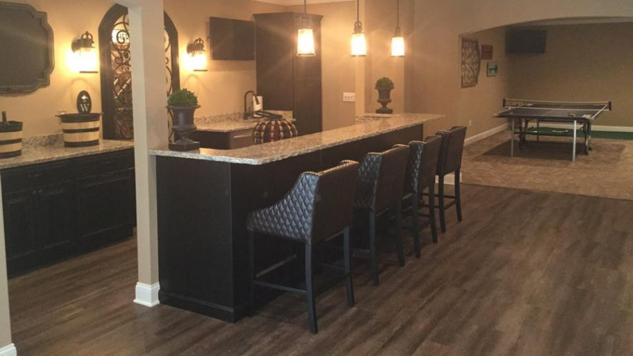Laminate is just one of several good basement flooring options you can  choose for your remodeling project. (Photo courtesy of Joe Zago)
