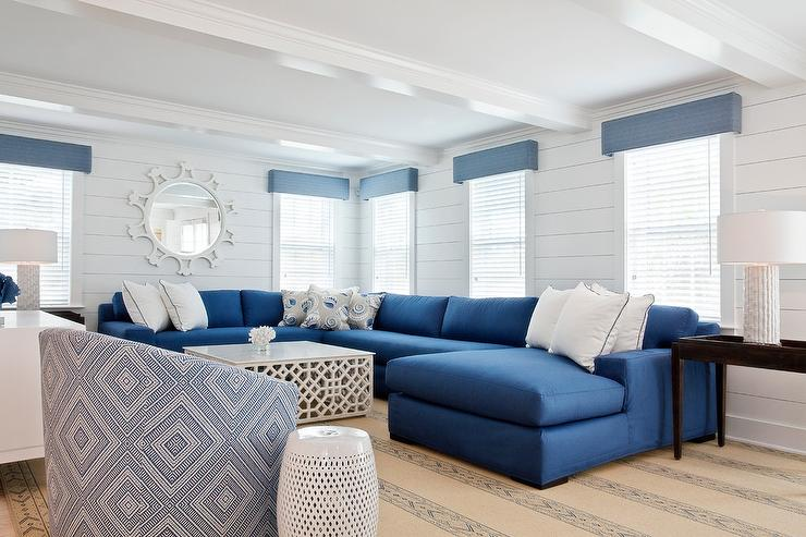 Blue Sectional with White Coffee Table