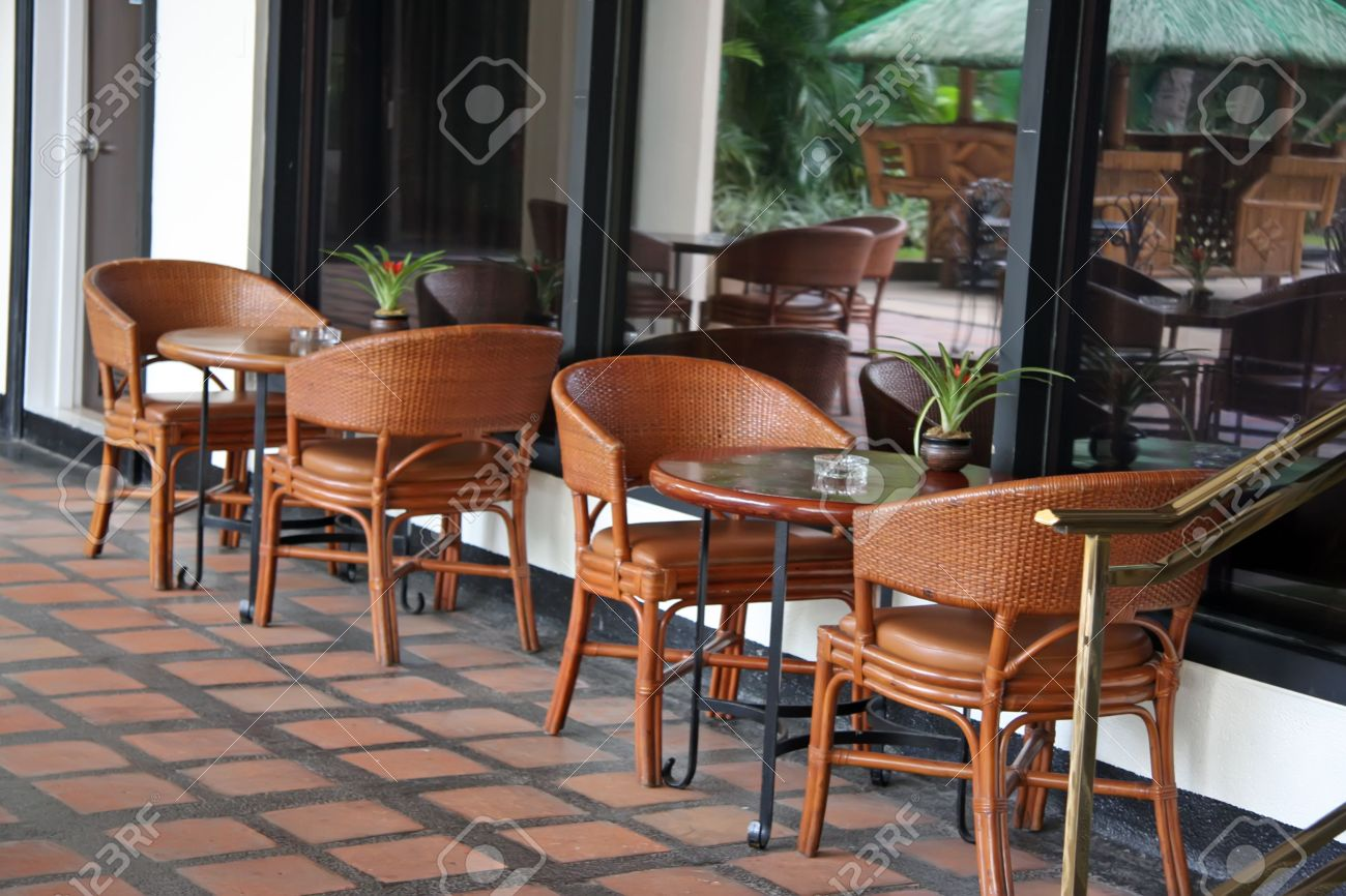 Open air poolside tropical casual restaurant cafe furniture Stock Photo -  2048791
