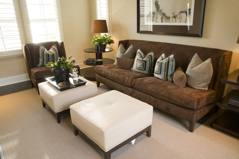 Compact living room with dark mocha chair and armless sofa, contrasting  with white single-