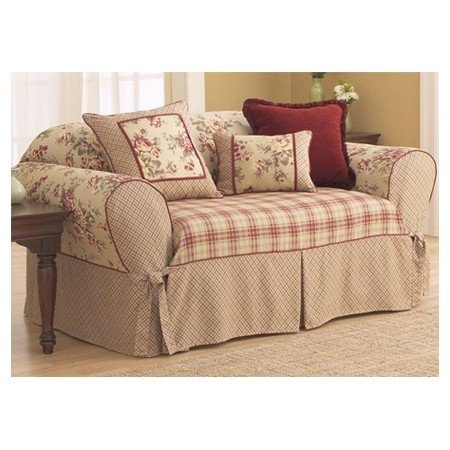 It is made of heavy-duty beige cotton with a colourful floral-pattern. It  protects and gives a completely new look to seedy sofas. This cover
