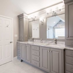 Bathroom with custom gray cabinets and dual sinks with a mirror each  Wyomissing, PA