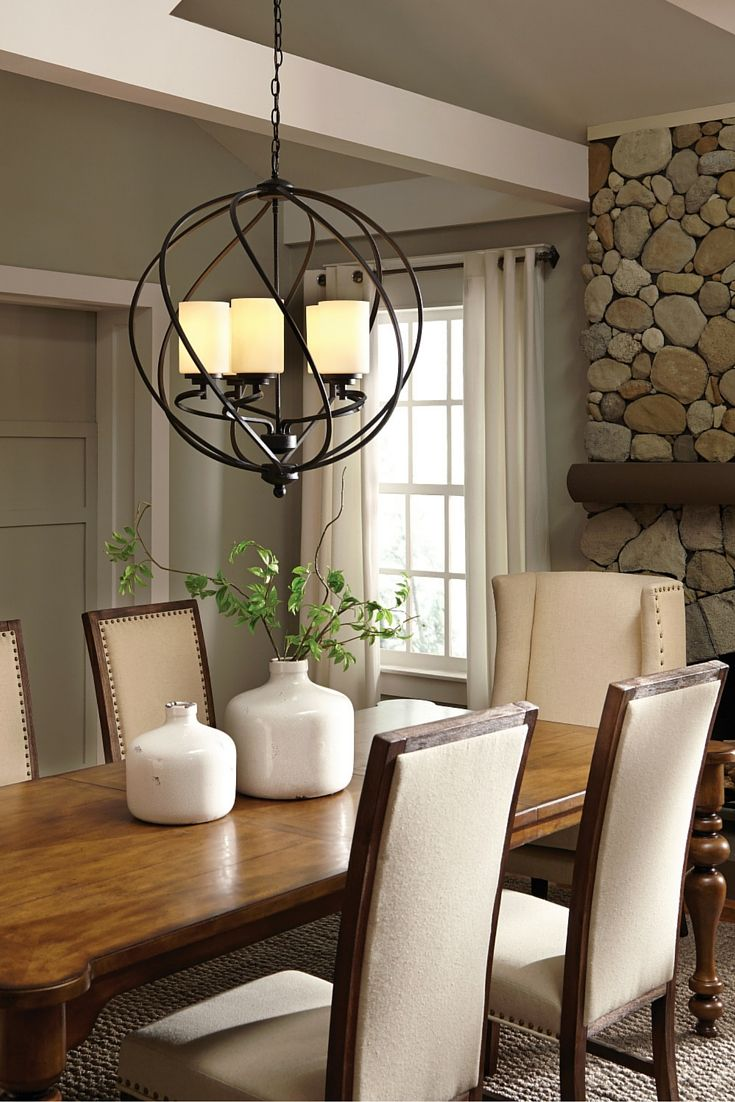 The transitional Goliad lighting collection by Sea Gull Lighting has a  sophisticated style combining divergent design elements. The rustic wrought  iron has