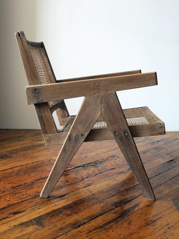 Stunning example of a Pierre Jeanneret easy armchair from Chandigarh, with  a natural, sun