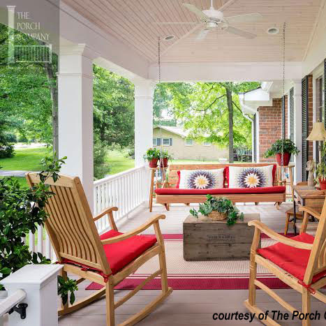 colorful cushions on beautiful front porch with porch swing